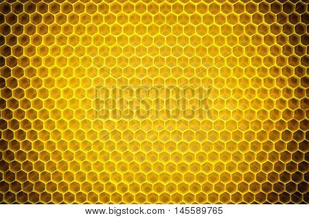 Circular honeycomb background. Elliptic dark gradient beeswax