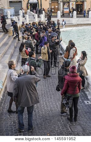 Italy, Rome, Fontana di Trevi 13/12/2015 - Typical Trevi Fountain scene with crowds that flock to get close to the water