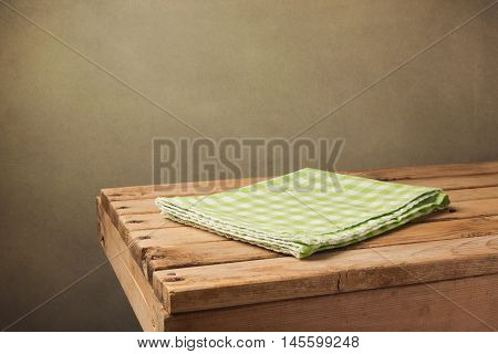 Vintage wooden table with green checked tablecloth