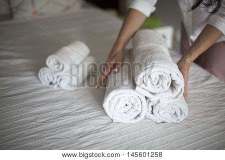 Maid doing room service in hotel. Preparing room in Hotel