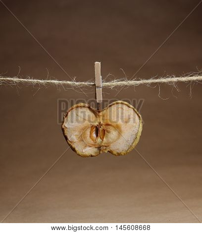 apple dried  on a rope with a clothespeg