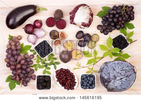 Purple fruit and vegetables, top view