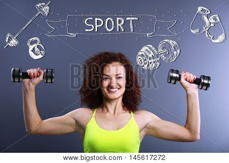 Sporty young woman exercising with dumb bells on gray background. Sport lifestyle concept. Diversity of sport icons on background.