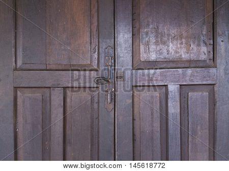 Old metal hasp on old vintage wooden door.