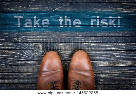 Take the risk message and business shoes on wooden floor