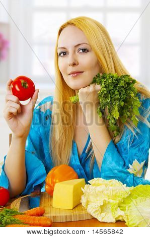 Blonde Woman On Light Kitchen At Home With Vegetables