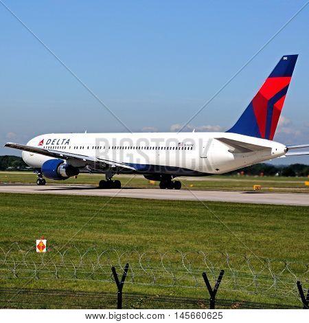 MANCHESTER, UNITED KINGDOM - AUGUST 17, 2014 - Delta Airlines Boeing 767 taxiing at Manchester Airport Manchester England UK Western Europe, August 17, 2014.