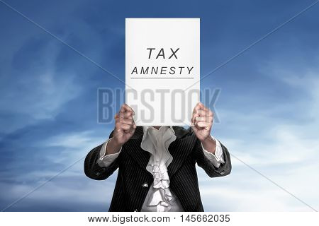 The Human Holding Paper Reads Tax Amnesty