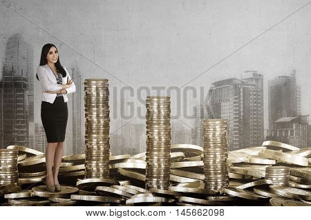 Success And Rich Business Woman Saving Gold Coin