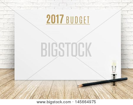 2017 Budget Year Text On White Paper Poster With Black Pencil And Lightbulb On Wood Plank Floor And