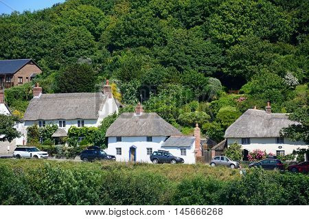 LULWORTH COVE, UNITED KINGDOM - JULY 19, 2016 - Thatched cottages along the village entrance Lulworth Cove Dorset England UK Western Europe, July 19, 2016.