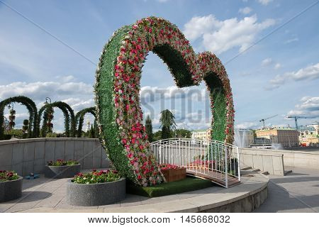 Bridge to bench reconciliation in the center of the arch of flowers bridge of love landmark
