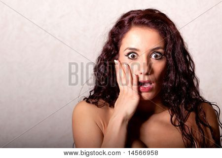 Brunette woman with surprised facial expression