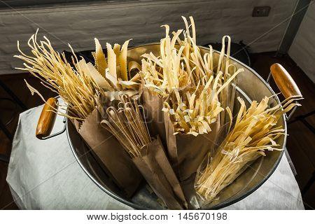 Various types of pasta on a metal tub