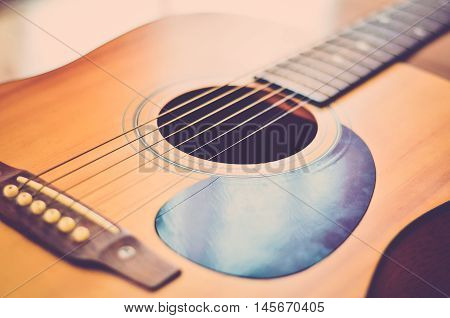 Guitar (vintage). Guitar strings close up. Rock
