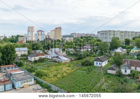 Garden plots and orchards near the multi-storey residential buildings in the city
