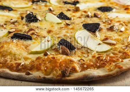 Fresh Pizza with apples and almonds and chees