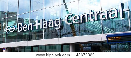 Leiden, Netherlands - April 7, 2016: Sign at facade of central station in Hague, close-up Den Haag Centraal lettering