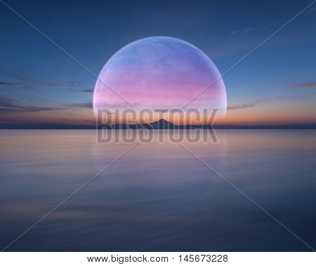 Big beautiful planet over the sea horizon rises at dawn. Futuristic concept with copy space.