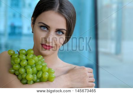 Girl Holding Grapes On The Chest And Hugs It