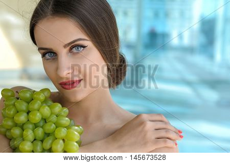 Woman Holds Grapes In The Chest And Hugs It