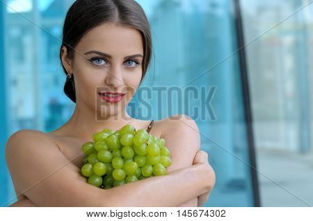 Girl Put A Bunch Of Grapes On Her Chest