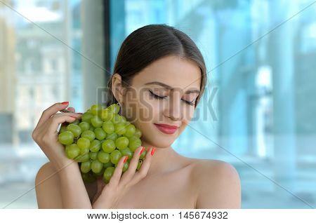 Girl Holding A Large Bunch Of Ripe Grapes