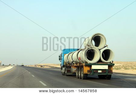 A truck with huge pipes