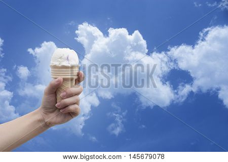 a woman hand holding Ice cream cone with summer blue sky and clouds in background,colorful picture style