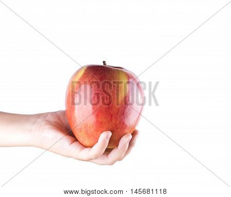 Children Hand With An Apple Isolated On White Background.  Big Juicy Applev
