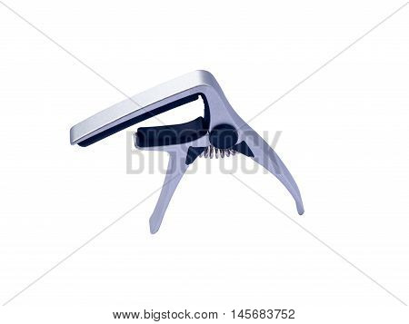 Guitar silver capo on white background close up