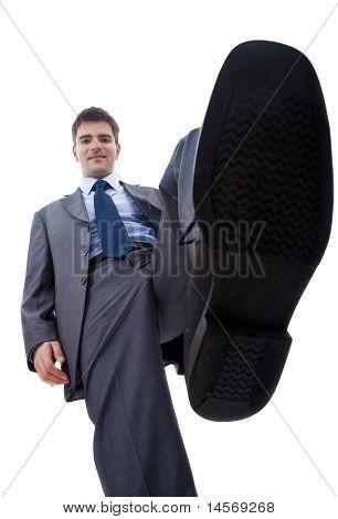 lächelnd Business Mann Steping auf etwas
