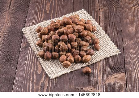 Hazelnuts on rustic background. Hazelnut kernels placer.