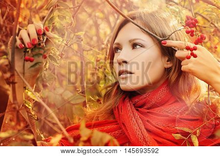 beautiful Perfect Woman with Autumn Foliage Outdoors