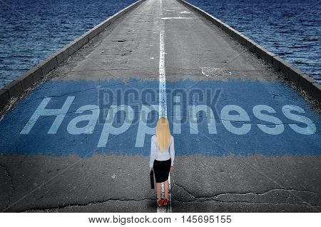 Happiness message on road and business woman