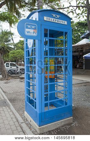 Pattaya, Thailand - Jul 17, 2015: Close up of a telephone booth and wi-fi pot of TOT on a street. TOT Public Company Limited offers telecommunications and other related services in Thailand.