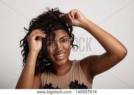 Black Woman Have Fun With A Wig. Curly Hair Wig