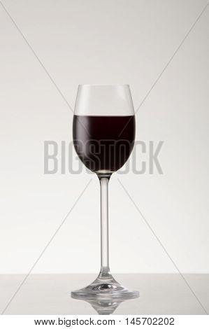 Red dessert wine in a dessert wine glass.