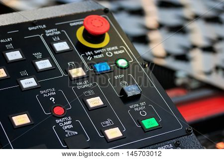 Control panel of laser cutting machine. Closeup view. Selective focus.