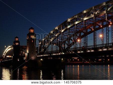 Bridge of Peter the Great St. Petersburg moonlit night on the river Neva