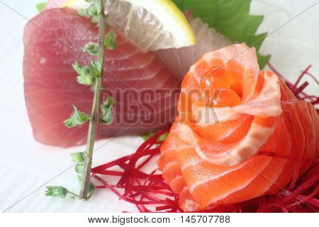 Japanese sashimi set consisting of salmon tuna and hamachi