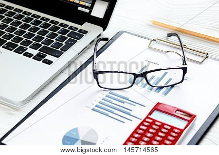 workplace economist at bright new office table with laptop