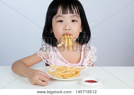Asian Chinese Little Girl Refusing Eating French Fries
