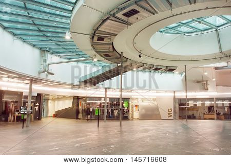 VIENNA, AUSTRIA - JUN 6, 2016: Empty space of the modern shopping mall inside the Gasometers former gas tanks on June 6, 2016. The containers of Gasometers were built from 1896 to 1899
