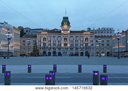 TRIESTE ITALY - DECEMBER 20: Unity of Italy Square at Winter Dusk in Trieste on DECEMBER 20 2012. Main Great Square of Italian Unity With Big Christmas Tree in Trieste Italy.