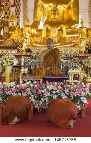 People Pay Respect To Buddhist Monk  In Temple