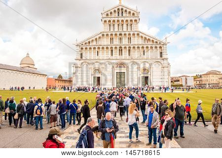 Pisa, Italy - June 02, 2016: Tourists near Pisa cathedral on the field of Miracles in Pisa town in Italy