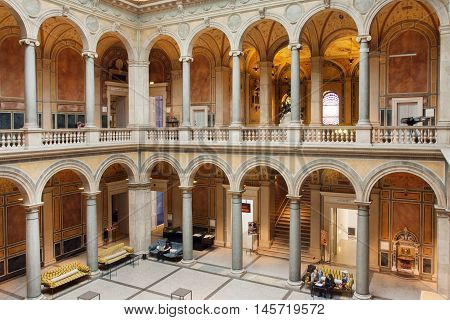 VIENNA, AUSTRIA - JUN 10, 2016: Tourists resting inside the courtyard of Museum of Applied Arts with stone columns on June 10, 2016. MAK has collection of design architecture contemporary art from 1864
