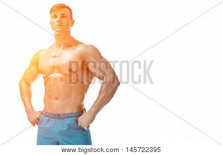 Strong Athletic Man showing muscular body and sixpack abs isolated on white background. with sun flare. copyspace