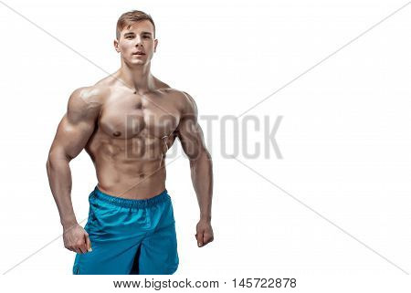 Strong Athletic Man showing muscular body and sixpack abs isolated on white background. copyspace